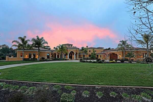 """Built in 2009, the """"world-class estate"""" on 2.3 manicured acres measures 13,790 square feet and has six bedrooms and 7.5 baths—all on a single level."""