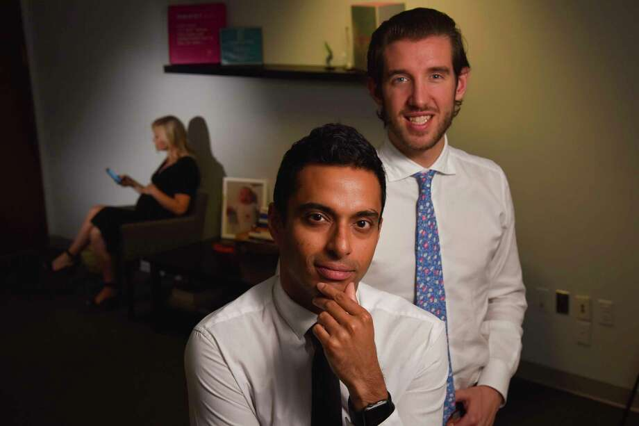 Anish Sebastian, front, and Juan Pablo Segura, created the start-up Babyscripts, which produces software to reduce the number of office visits made by pregnant women. Photo: Washington Post Photo By Jahi Chikwendiu. / The Washington Post