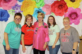 Sharon Wright (center), Plainview ISD's executive director for curriculum and instructional services, poses with high school counselors Amy Hagerman (left), Valinda Parker, Courtney Wood and Robin Sweeney at the retirement reception held for Wright on Monday. The counselors donned colorful eye glasses in honor of Wright who has dedicated 39 years to her career in education.