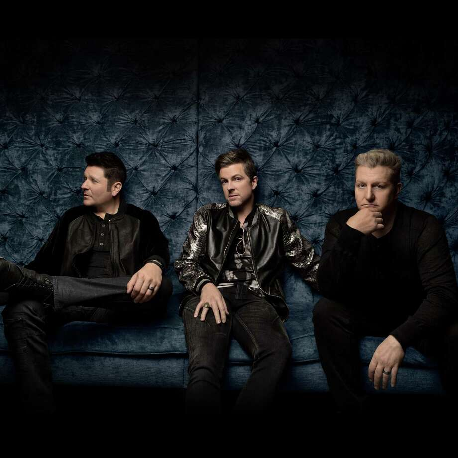 Rascal Flatts, Jay Demarcus, left, Joe Don Rooney and Gary LeVox, rock Hartford's Xfinity Theatre on June 8. Photo: Live Nation / Contributed Photo