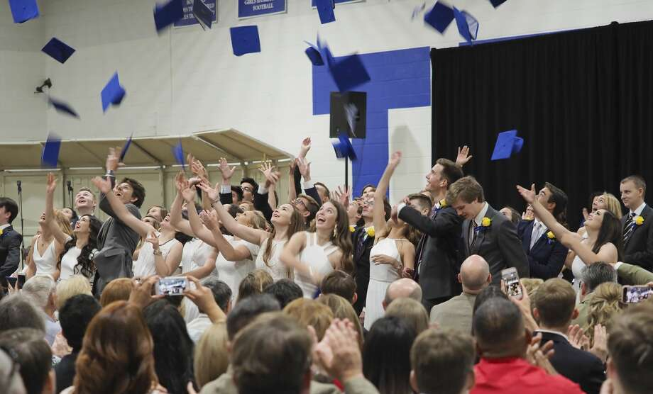 Trinity School graduates toss their hats in the air 05/25/18 at the end of the 28th commencement ceremony. Tim Fischer/Reporter-Telegram Photo: Tim Fischer/Midland Reporter-Telegram