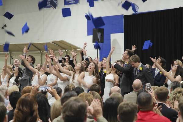 Trinity School graduates toss their hats in the air 05/25/18 at the end of the 28th commencemnt ceremony. Tim Fischer/Reporter-Telegram