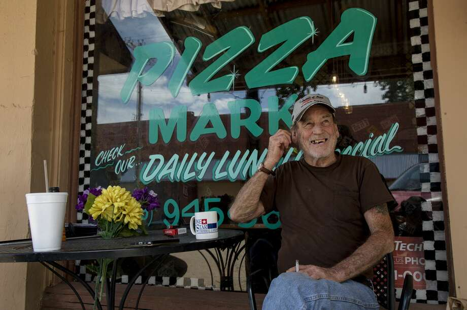 Carlton Edgar drinks coffee at Pizza Mark, the town's only restaurant. Photo: Jon Shapley/Houston Chronicle