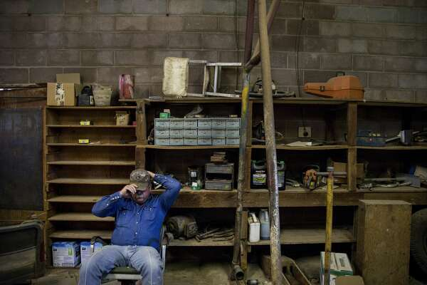 Lanham Martin, a Shackelford County commissioner, sits in a county shed in Moran.
