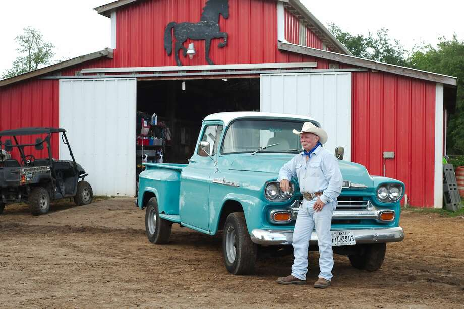 "Pasadena Poet Laureate Charles ""Smokey"" Culver stands beside his vintage 1958 Chevrolet Apache pickup truck at a stable in Hitchcock, TX Friday, May 25. Photo: Kirk Sides/Houston Chronicle"