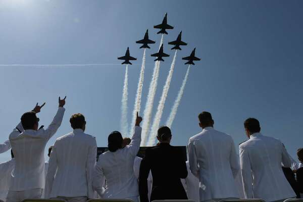 The Blue Angels fly over the Class of 2018 midshipmen graduating Friday from the U.S. Naval Academy in Annapolis, Md.