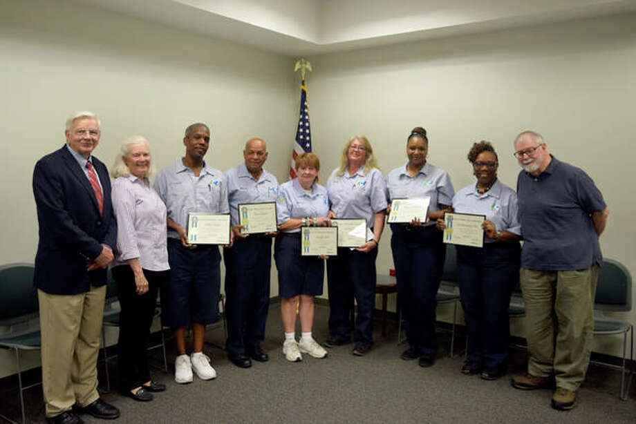 Pictured are, from left, ACT Executive Director Jerry Kane, ACT Trustee Sally Ferguson, ACT drivers Calvin Payne, Efrain Franco, Marilyn Elick, Reatha Duff, Monte O'Bannon, Zereeta Kinney-Lee, and ACT Trustee Dan Corbett. Photo:       For The Telegraph