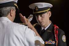 Cadet David Alvarez, right, salutes Captain William Glass Jr., Senior Naval Science Instructor during The Bridgeport Academy's second annual end of year award ceremony at Bridgeport University on Friday, May 25, 2017. This is the school's second year with a graduating class. Cadets are trained for a future in either Military Service or as First Responders.
