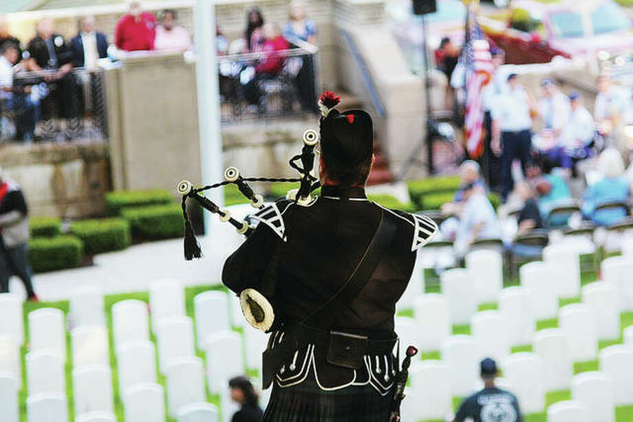 """Scotland the Brave"" is performed by pipes and drums last year during the 12th Annual Memorial Day Sunset Ceremony held at Alton National Cemetery. Photo:       Nathan Woodside 