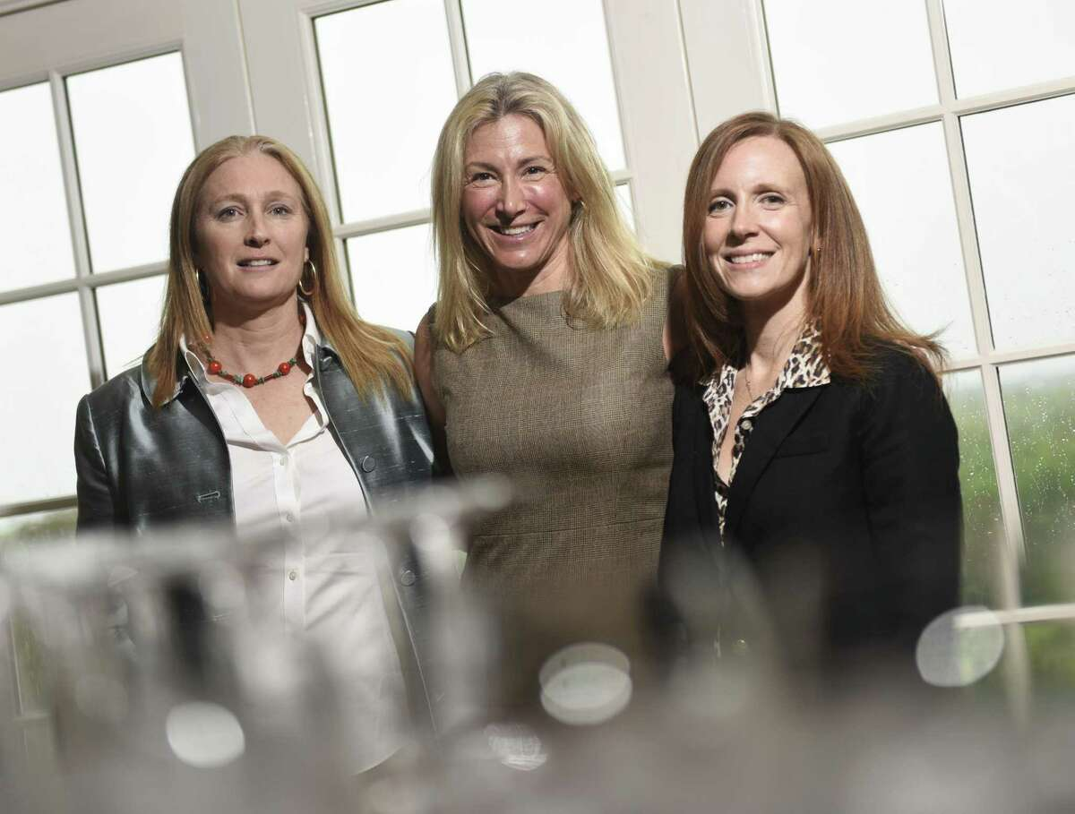 1843 Capital General Partner Alison Andrews Reyes, left, Founding Partner Tracy Chadwell, center, and CFO Gwen Weiss pose at the Moffly Media Women in Business Luncheon at Greenwich Country Club in Greenwich, Conn. Wednesday, May 16, 2018. Chadwell won the Women's Business Advocate award for her firm, which invests in women-led companies.