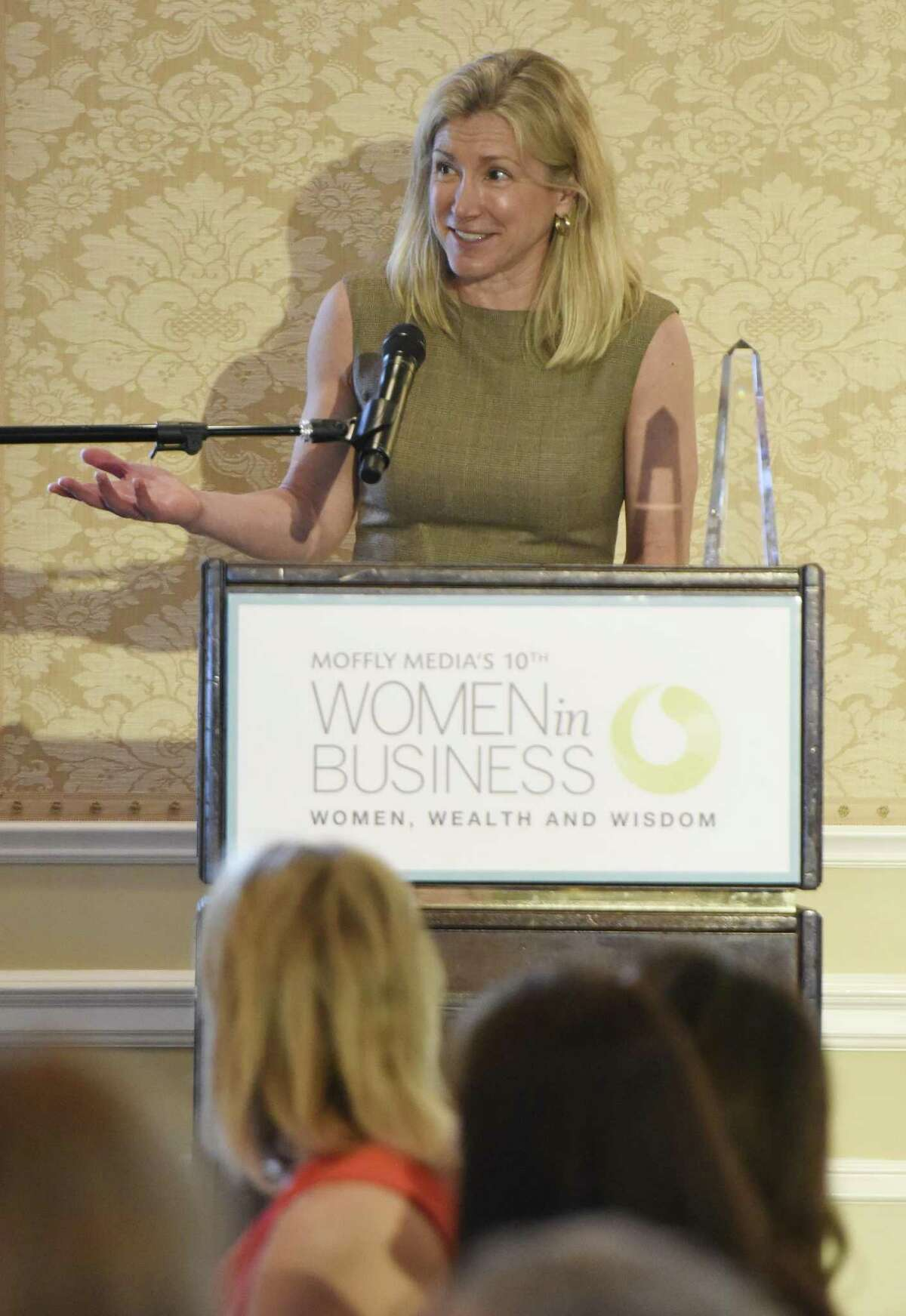 1843 Capital Founding Partner Tracy Chadwell accepts an award at the Moffly Media Women in Business Luncheon at Greenwich Country Club in Greenwich, Conn. Wednesday, May 16, 2018. Chadwell won the Women's Business Advocate award for her firm, which invests in women-led companies.