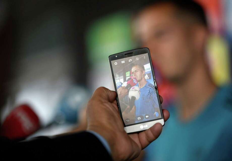 A person takes a photo with a smartphone as Real Madrid's Spanish midfielder Lucas Vazquez addresses journalists during Real Madrid's Media Open Day ahead of their UEFA Champions league final footbal match against Liverpool FC, in Madrid on May 22, 2018. Photo: GABRIEL BOUYS /AFP /Getty Images / AFP or licensors