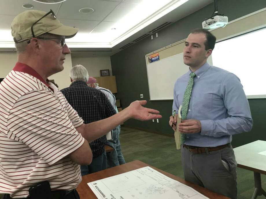 Residents ask the Connecticut Department of Transportation personnel questions about the proposed proposed seawall rehabilitation on Limewood Avenue, or Scenic Route 146, in Branford. Photo: By Jessica Lerner