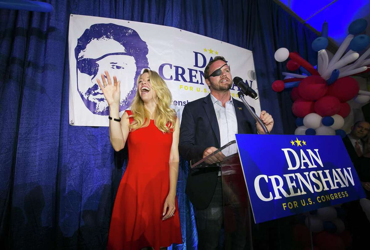 Republican congressional candidate Dan Crenshaw reacts to the crowd with his wife, Tara, as he comes on stage to deliver a victory speech during an election night party at the Cadillac Bar, Tuesday, May 22, 2018 in Houston. Crenshaw was in a run-off with Kevin Roberts for Texas congressional district 2. ( Mark Mulligan / Houston Chronicle )