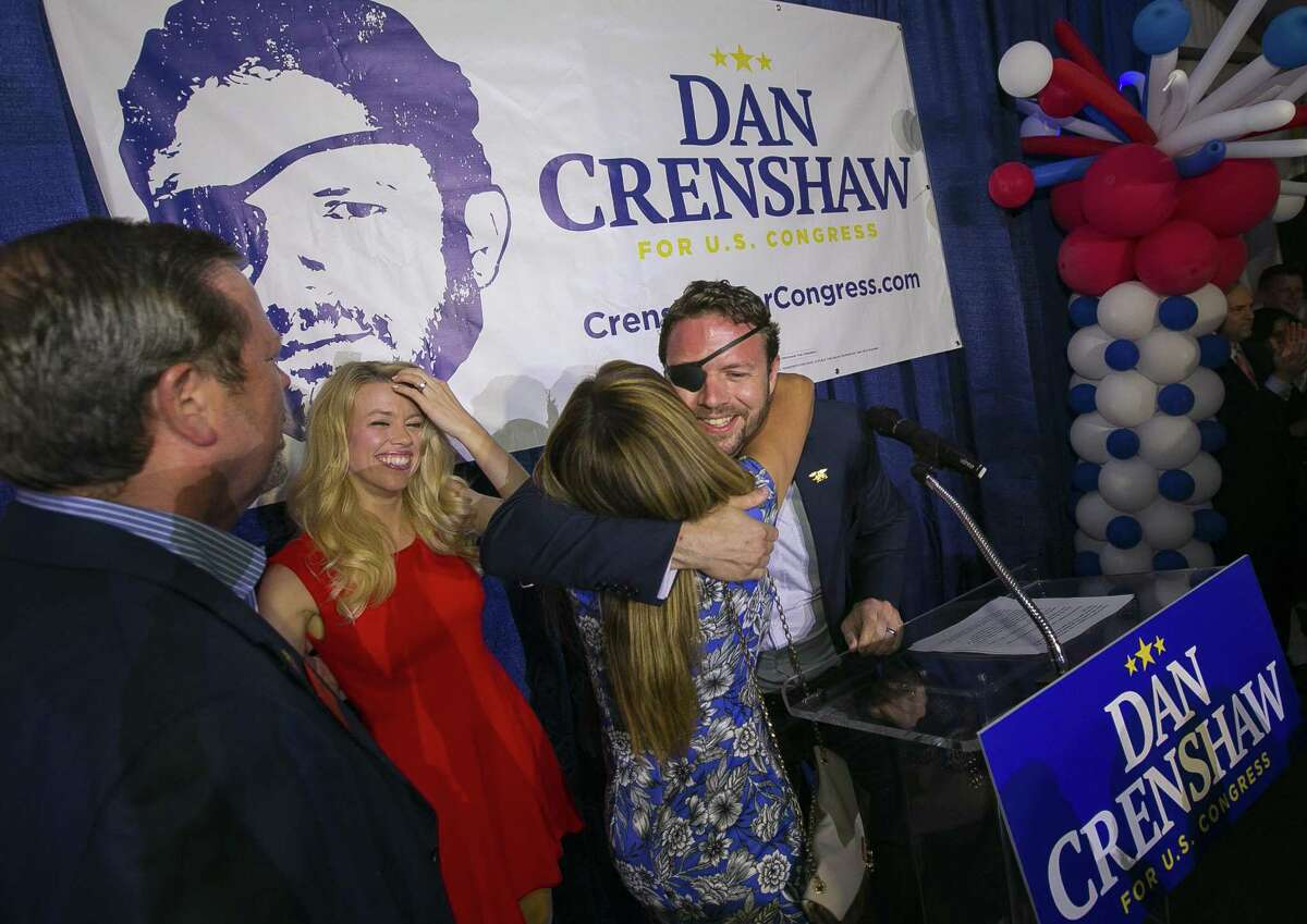 Republican congressional candidate Dan Crenshaw hugs his step-mother, Carmen Crenshaw, when coming on stage with his wife, Tara, and father, Jim, to deliver a victory speech during an election night party at the Cadillac Bar, Tuesday, May 22, 2018 in Houston. Crenshaw was in a run-off with Kevin Roberts for Texas congressional district 2. ( Mark Mulligan / Houston Chronicle )