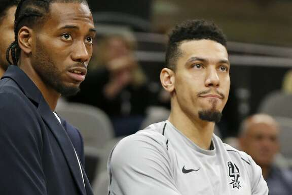 San Antonio Spurs' Kawhi Leonard and Danny Green watch the final seconds of the game against the Indiana Pacers Sunday Jan. 21, 2018 at the AT&T Center. The Pacers won 94-86.
