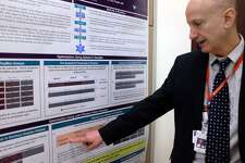 Paul Fiedler, a doctor researching Lyme disease at the Western Connecticut Health Network, points to a poster showing his team's results. The researchers are developing a test that looks for the genes of Lyme-causing organism instead of the antibodies the body releases in response. A new test could allow Lyme disease to be detected earlier and help scientists begin to understand why some patients' symptoms persist after treatment.