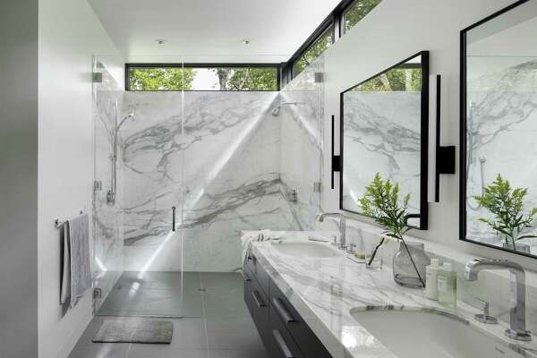 Bon 1of21The Calacatta Gold Marble Walls In This Bath Are Warmer, With Stronger  Veining Than Carrera. The Bath Also Has A Curb Less, Roll In Shower Both  For ...