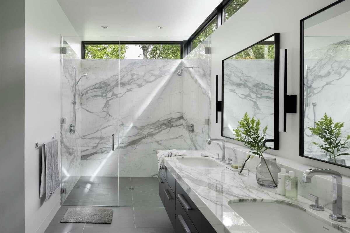1of 21The Calacatta Gold marble walls in this bath are warmer, with stronger veining than Carrera. The bath also has a curb-less, roll-in shower both for ...