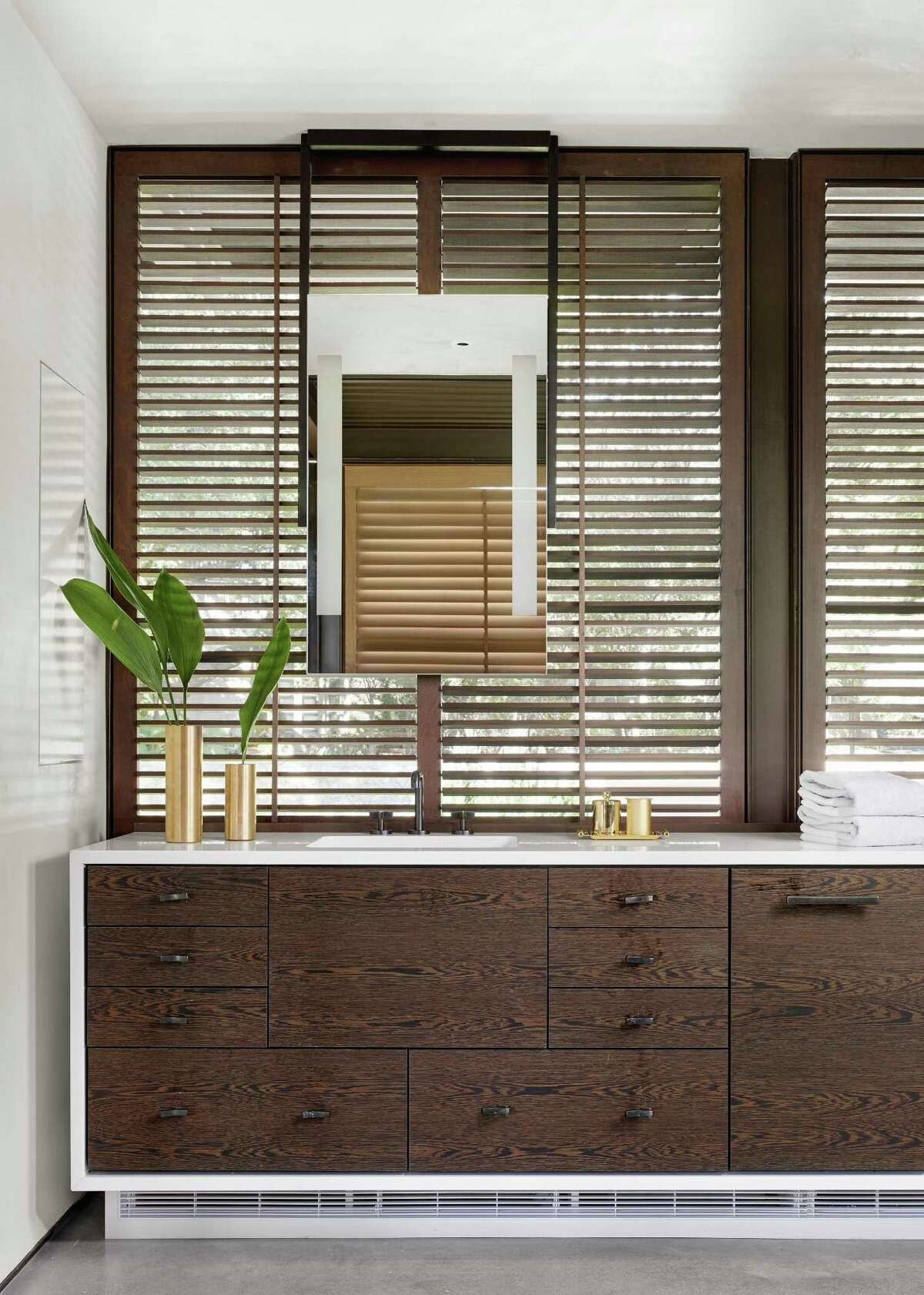 Wood has become a popular, if, perhaps, unintuitive, material sometimes used in master bathrooms. Properly sealed and maintained, woods such as white oak and mesquite not only look luxurious, but they?'ll also be able to withstand the rigors (and humidity) of a master bath for many years.