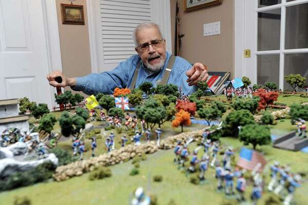 Charles Trudeau discusses the intricacies of his historical dioramas inside his West Hill Rd. home in Stamford, Conn. on Tuesday, May 15, 2018. Trudeau's collection began when he moved to Stamford in 1981 and he now has more than 10,000 toy soldiers and nearly 150 reference books in his possession.