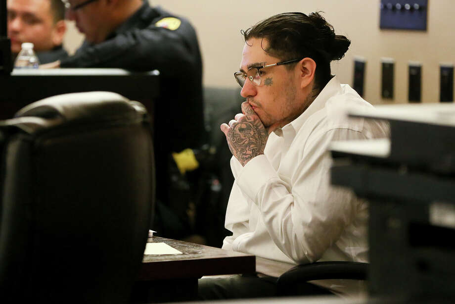 Daniel Moreno Lopez, 31, sits in the courtroom during the first day of testimony in his retrial of  in the 379th state District Court at the Cadena-Reeves Justice Center on Friday, May 25, 2017.  Lopez is one of three defendants charged with killing Jose Luis Menchaca who was beaten with aluminum baseball bats, his limbs cut off and grilled on a barbecue pit.  Lopez's first trial in March, 2017 ended in a mistrial.  MARVIN PFEIFFER/mpfeiffer@express-news.net Photo: Marvin Pfeiffer, San Antonio Express-News / Express-News 2018