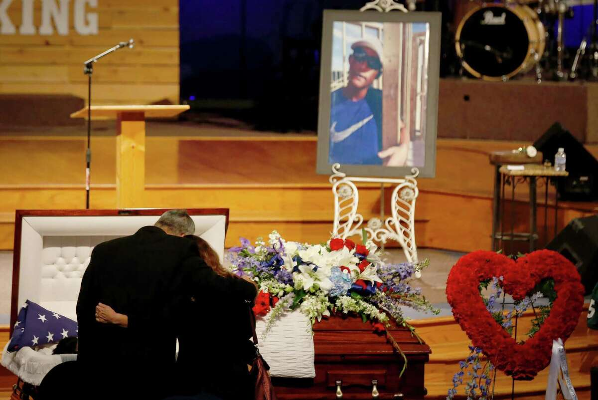 Mourners embrace in front of Christian Riley Garcia's casket during his funeral service at Crosby Church on Friday, May 26, 2018, in Crosby, Texas. The 15-year-old Santa Fe High School student was one of 10 students and staff slain in a mass shooting at the school on Friday, May, 18.