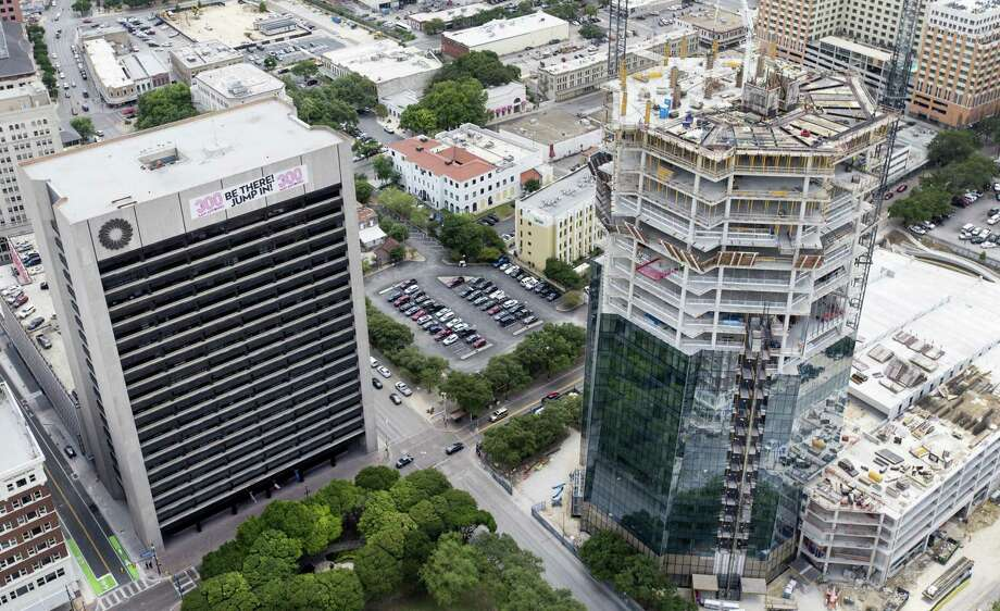 The still-under- construction Frost Tower rises Wednesday, May 23, 2018 in an aerial image to the right of the original Frost Tower. Photo: William Luther / San Antonio Express-News / © 2018 San Antonio Express-News