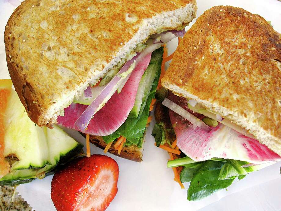 The Awesome Rawsome sandwich includes avocado, jalapeño hummus, watermelon radish, carrots, tomato, spinach and pumpkin seeds at Thyme for Lunch, which has relocated from Stone Oak to the Medical Center area. Photo: Mike Sutter /Staff File Photo