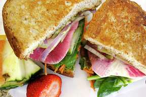 The Awesome Rawsome sandwich includes avocado, jalapeño hummus, watermelon radish, carrots, tomato, spinach and pumpkin seeds at Thyme for Lunch, which has relocated from Stone Oak to the Medical Center area.
