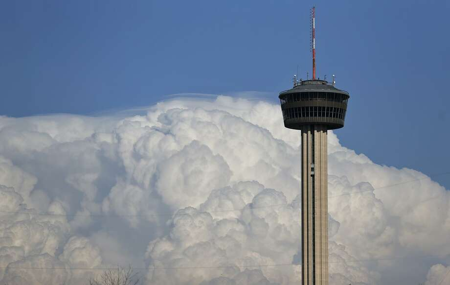 Storm clouds are pictured behind the Tower of the Americas March 18. It is an apt metaphor. Those storm clouds of socioeconomic inequity have been gathering for a while — and, arguably, we're already in the midst of the storm. Photo: Edward A. Ornelas /San Antonio Express-News / © 2018 San Antonio Express-News