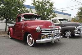 This 1952 Chevy truck and the 1954 GMC truck by its side were shown at the first Bombs Car Show. (Photo by Heidi Van Horne)