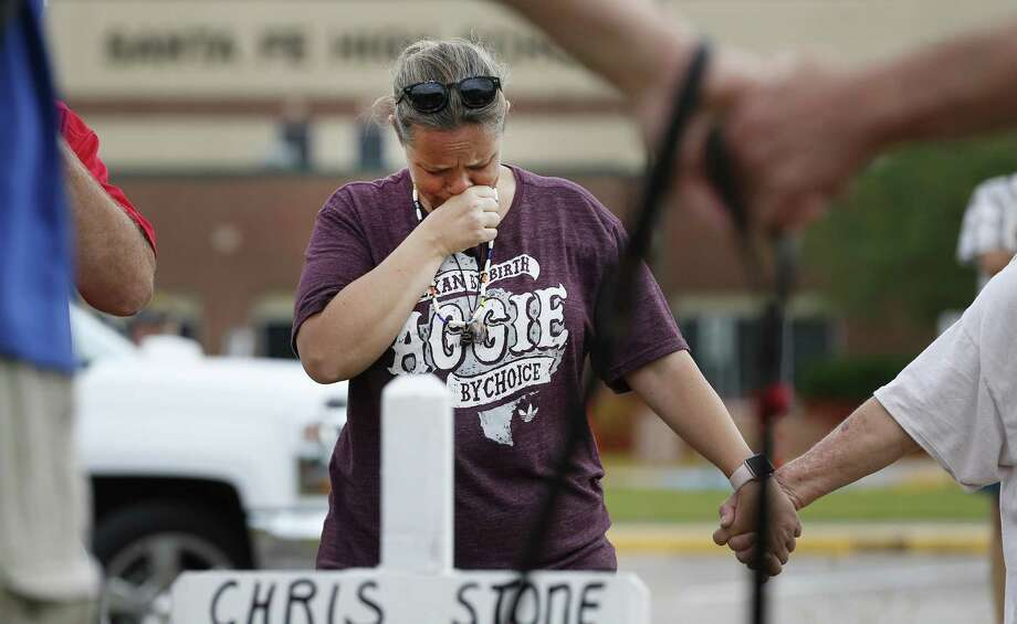 Santa Fe resident, Lori Simmons cries during a moment of silence in front of Santa Fe High School Monday in Santa Fe. It will require more than moments of silence and thoughts and prayers to address the issue of mass shootings, particularly those that occur in schools. Photo: Steve Gonzales /Houston Chronicle / © 2018 Houston Chronicle