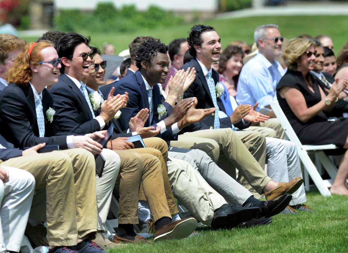 Graduates have a laugh during a light moment in the Canterbury School in New Milford's graduation ceremony Friday, May 25, 2018.