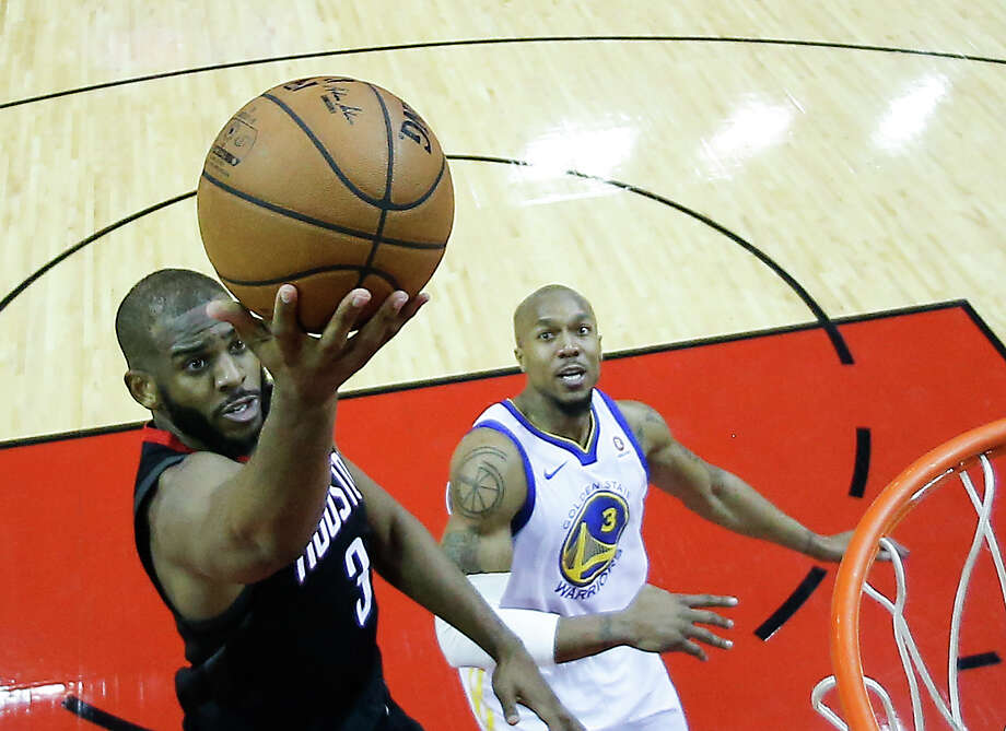 Houston Rockets guard Chris Paul (3) shoots a layup past Golden State Warriors forward David West (3) during the second half of Game 5 of the NBA Western Conference Finals at Toyota Center on Thursday, May 24, 2018, in Houston. ( Brett Coomer / Houston Chronicle ) Photo: Brett Coomer/Houston Chronicle / © 2018 Houston Chronicle