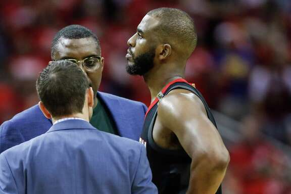 Houston Rockets guard Chris Paul (3) talks to the Rockets training staff after suffering a hamstring injury during the second half of Game 5 of the NBA Western Conference Finals against the Golden State Warriors at Toyota Center on Thursday, May 24, 2018, in Houston.