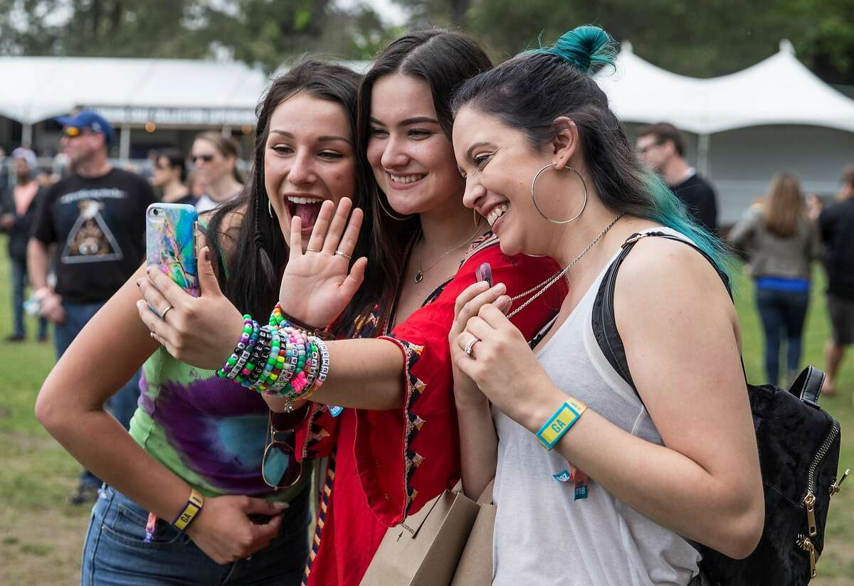 (From left) Mila Sugarman, Cianna Book and Liz Granger of Santa Rosa FaceTime with a friend while watching Flor perform on the Midway Stage during the first day of Bottle Rock Music Festival in Napa, Calif. Friday, May 25, 2018