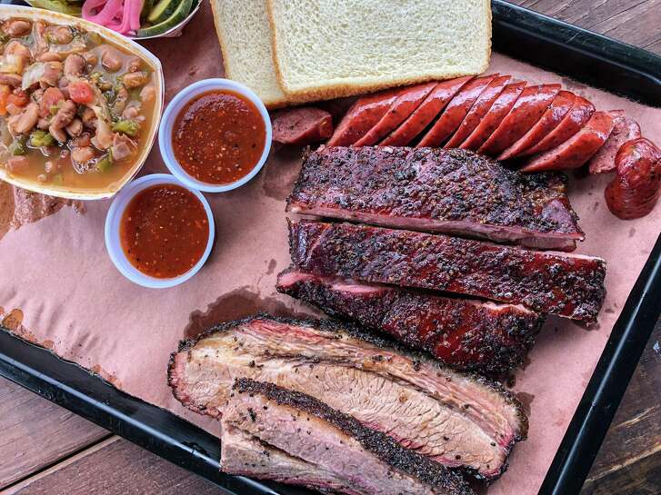 The trinity (brisket, ribs and sausage) with a side of beans at Willow's Texas BBQ
