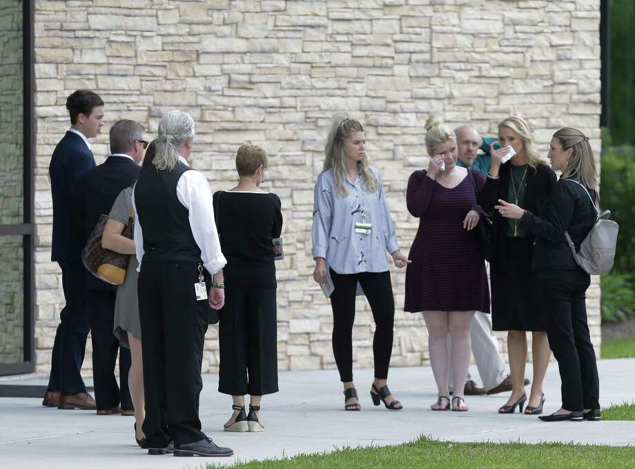 People leave from the Bay Area Christian Church, Friday, May 25, 2018 in League City after the funeral for Cynthia Tisdale, a substitute teacher who was killed during the mass shooting at Santa Fe High School. Photo: Melissa Phillip, Houston Chronicle
