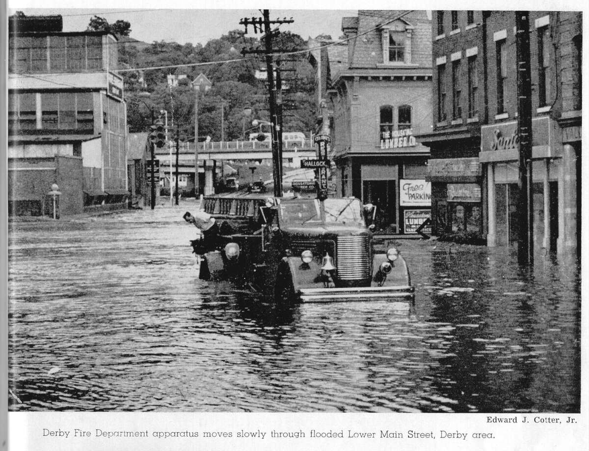 07/28/05, A Derby fire truck make it's way up a flooded Main St. in Derby, looking southwest towards Route 8. For feature on Flood of 1955.