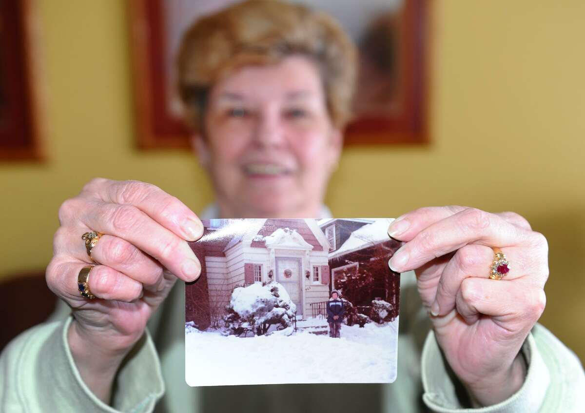 Rosie Kelly shows a picture of herself from the Blizzard of 1978 as she enjoys a blizzard party with friends at the Savin Beach Condo complex on Beach Street after a blizzard pounded the region in West Haven, Conn. on Saturday February 9, 2013.