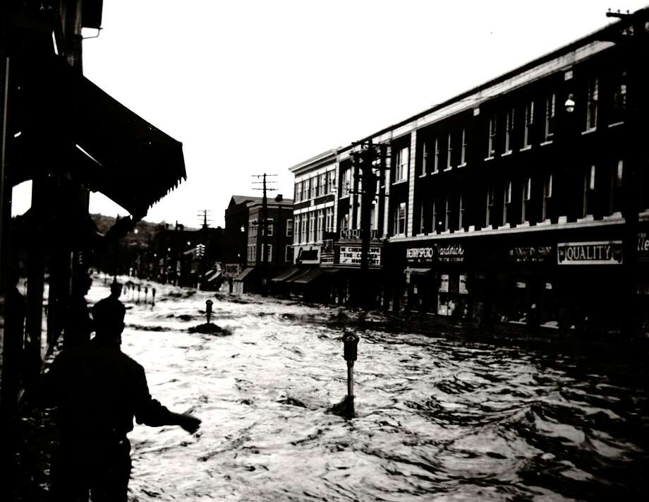 FILE PHOTO  Photo courtesy Ansonia Public Library : Flood of 1955, looking south down Main St. from Ansonia City Hall. Photo: File Photo / File Photo / Connecticut Post file photo