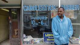 "Jules Stewart, 49, stands in front of the Candlestick Barber Shop on Third St. in the Bayview district of San Francisco on May 25th, 2018. When asked about his thoughts regarding the DA's decision to not file charges against the police officers that shot and killed Mario Woods, he said, ""There's no accountability. They're killing unarmed people of color. The police need to be policed."""