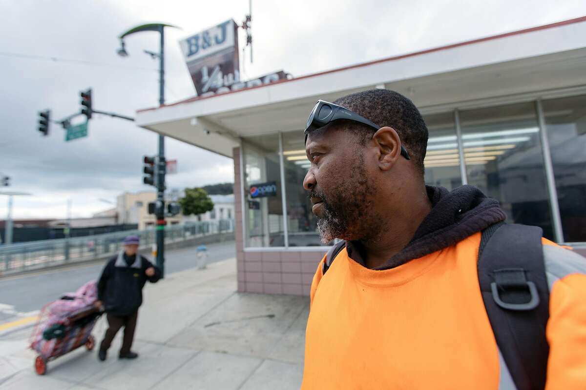 """Derek Tillman, 50, and a resident of the Bayview District of San Francisco, in front of B&J 1/4 lb Burgers on the corner of 3rd and Paul, across the street from where Mario Woods was shot and killed by SFPD. Mr. Tillman grew up nearby and spoke about his concern about the possibility of walking down the street and """"fitting the description."""""""