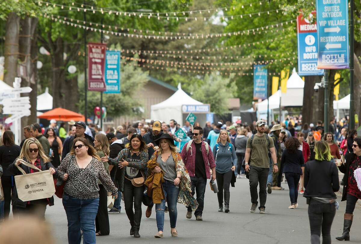 Hundreds make their way down Main Street during the first day of Bottle Rock Music Festival in Napa, Calif. Friday, May 25, 2018