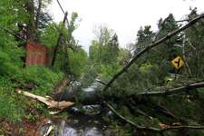 Aftermath from Tuesday's storm along Ball Pond Road in New Fairfield, Conn., on Wednesday May 16, 2018.