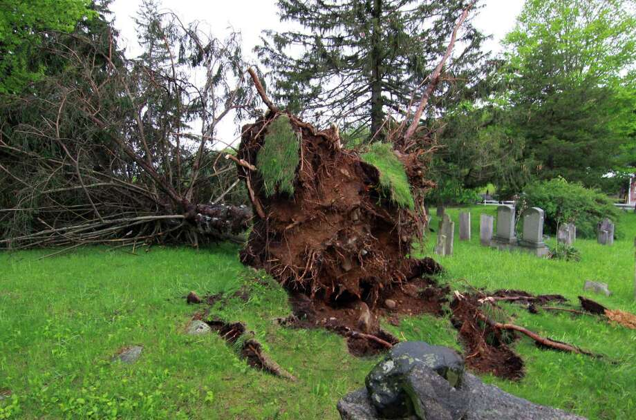 A tree is toppled from Tuesday's storm at the New Fairfield Cemetery in New Fairfield, Conn., on Wednesday May 16, 2018. Photo: Christian Abraham / Hearst Connecticut Media / Connecticut Post