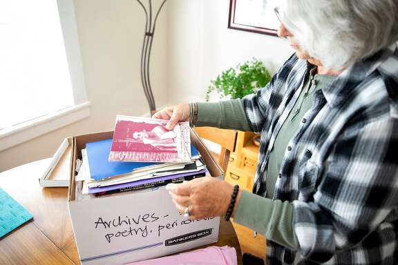Rebecca Silverstein goes through a bankers box full of lesbian books, pamphlets, poetry and articles dating from the 1970's and 1980's in Oakland, Calif. on Saturday, May 19, 2018. The Bay Area Lesbian Archives (BALA) is run by Lenn Keller, Rebecca Silverstein and Sharon Davenport. All three women are compiling their own memorabilia from the Bay Area lesbian community of the 1970's and 80's as well as receiving donations from others in the Bay Area. Everything from original vinyl records and shirts to pamphlets, flyers and weekly lesbian run newspapers are a part of the growing collection.
