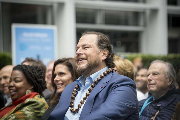 Marc Benioff, chairman and chief executive officer of Salesforce.com Inc., listens to a presentation during the grand opening ceremonies for the Salesforce Tower in San Francisco, California, U.S., on Tuesday, May 22, 2018. The building, the�tallest office tower�west of the Mississippi river, opened with a ceremony crowded with local officials on Tuesday, representing the indelible mark San Francisco's largest private employer has made on the city. Photographer: David Paul Morris/Bloomberg
