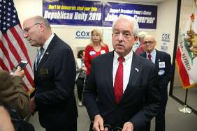 GOP candidates John Cox (right middle) for governor and Steve Bailey (left) for attorney general at a campaign event Thursday in Burlingame.